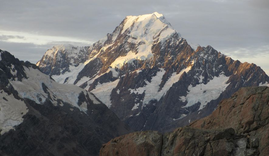 This March 30, 2014, photo shows Mount Cook, New Zealand's highest mountain, at sunset in Twizel, New Zealand. New Zealand lawmakers have joined together across the aisle to pass a bill aimed at combating climate change. The Zero Carbon bill aims to make New Zealand reduce its greenhouse gas emissions to the point the country becomes mostly carbon neutral by 2050. (AP Photo/Carey J. Williams, File)