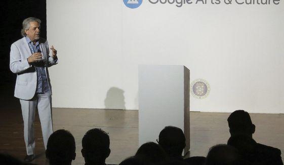 Luis Miranda, father of Lin-Manuel Miranda, announces a partnership with Google Arts & Culture to digitize more than 350 artworks, in San Juan Puerto Rico, Thursday, Nov. 7, 2019. (AP Photo/Danica Coto)