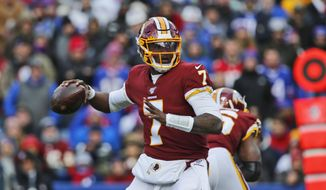 In this Nov. 3, 2019, file photo, Washington Redskins quarterback Dwayne Haskins looks to throw during the first half of an NFL football game against the Buffalo Bills, in Orchard Park, N.Y. The Redskins at the bye week of a lost season are a team without a definitive answer at quarterback, answers to questions on offense and defense and a visible organizational plan for the future. (AP Photo/John Munson) **FILE**