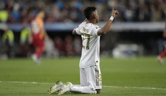 Real Madrid's Rodrygo celebrates after scoring his side's second goal during a Champions League group A soccer match between Real Madrid and Galatasaray at the Santiago Bernabeu stadium in Madrid, Wednesday, Nov. 6, 2019. (AP Photo/Bernat Armangue)