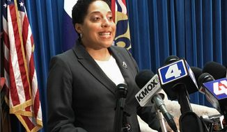 FILE - In this May 30, 2018 file photo St. Louis Circuit Attorney Kim Gardner speaks at a news conference in St. Louis. A special prosecutor who was assigned to determine if attorneys for former Missouri Gov. Eric Greitens threatened Gardner has found no evidence of criminal misconduct. The report from retired Boone County Associate Circuit Judge Michael Bradley was released Thursday Nov. 7, 2019. Gardner accused Greitens' lawyers of threatening her during Greitens' 2018 invasion of privacy case in St. Louis. The charges were eventually dropped but Greitens resigned in June 2018. (AP Photo/Jim Salter, File)