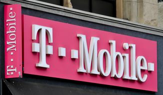 This April 30, 2018, photo shows a T-Mobile store in Herald Square in New York. (AP Photo/Bebeto Matthews, File)