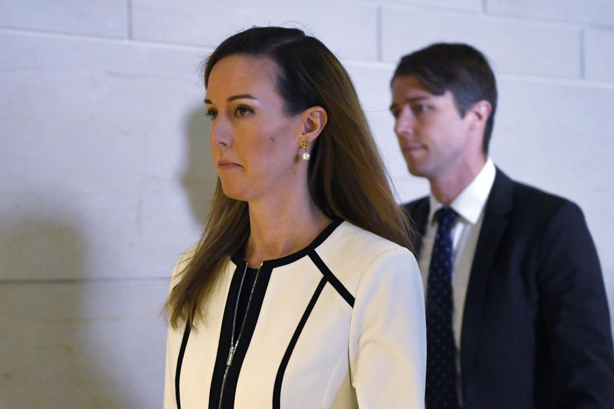 Jennifer Williams, a special adviser to Vice President Mike Pence for Europe and Russia and who is a career Foreign Service officer, arrives for a closed-door interview on Capitol Hill in Washington, Thursday, Nov. 7, 2019, in the impeachment inquiry on President Donald Trump's efforts to press Ukraine to investigate his political rival, Joe Biden. (AP Photo/Susan Walsh)