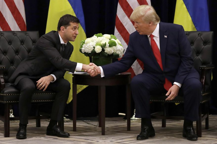 FILE - In this Sept. 25, 2019, file photo, President Donald Trump meets with Ukrainian President Volodymyr Zelenskiy at the InterContinental Barclay New York hotel during the United Nations General Assembly in New York. From the moment he was elected, Zelenskiy pushed for an Oval Office meeting with President Donald Trump. Zelenskiy saw such a visit as a quick win that would send a message to his Russian adversaries that the U.S. had his back. A visit to the Oval Office conveys power and instantly elevates the stature of any guest. (AP Photo/Evan Vucci, File)