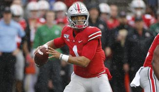 Ohio State quarterback Justin Fields drops back to pass against Wisconsin during the first half of an NCAA college football game Saturday, Oct. 26, 2019, in Columbus, Ohio. (AP Photo/Jay LaPrete) ** FILE **