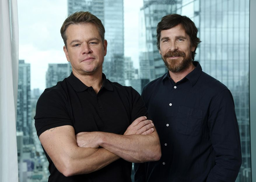 """This Sept. 8, 2019 photo shows co-stars Matt Damon, left, and Christian Bale posing for a portrait to promote their film """"Ford v Ferrari,"""" at the St. Regis Hotel during the Toronto International Film Festival. The film, directed by James Mangold, hits theaters on Nov. 15. (Photo by Chris Pizzello/Invision/AP)"""