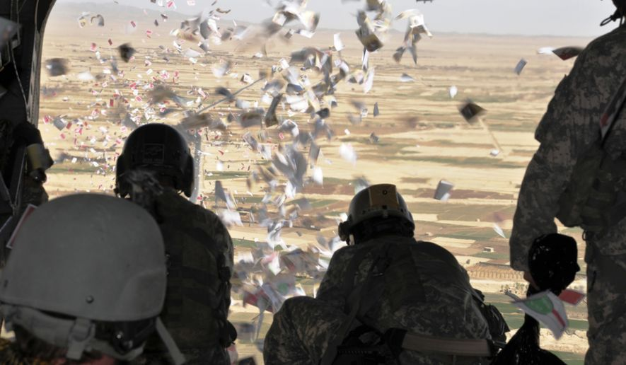 Members of the U.S. Army's 9th PSYOP Bn., 4th PSYOP Group drop leaflets over an Iraqi village. (Image: U.S. Army Special Operations Command)