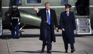 """President Donald Trump walks to board Air Force One for a trip to Atlanta to attend a fundraiser, and participate in the launch of """"Black Voices for Trump,"""" Friday, Nov. 8, 2019, in Andrews Air Force Base, Md. (AP Photo/ Evan Vucci)"""