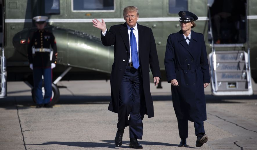 "President Donald Trump walks to board Air Force One for a trip to Atlanta to attend a fundraiser, and participate in the launch of ""Black Voices for Trump,"" Friday, Nov. 8, 2019, in Andrews Air Force Base, Md. (AP Photo/ Evan Vucci)"
