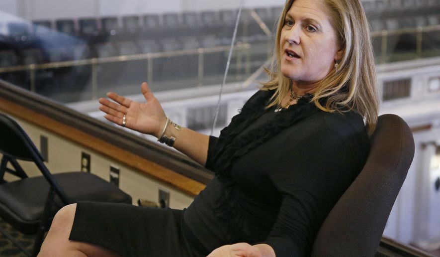 FILE - In this April 10, 2017, file photo, Trust Women's founder and CEO Julie Burkhart is pictured during an interview at the state Capitol in Oklahoma City. The Oklahoma City abortion clinic filed a lawsuit Friday, Nov. 8, 2019, challenging longstanding state laws that allow only physicians to perform abortions in Oklahoma, marking the sixth time in the past five years that the state's abortion restrictions have ended up in court. The lawsuit, which was filed on behalf of the Trust Women clinic, contends that such laws are unconstitutional because they restrict women's access to abortion without any valid medical basis. (AP Photo/Sue Ogrocki, File)