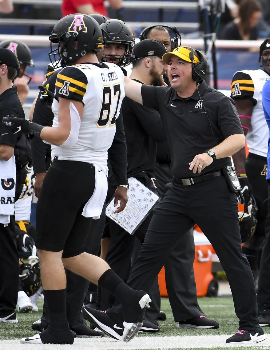 Appalachian State head coach Eliah Drinkwitz talks to Appalachian State tight end Collin Reed (87) during the first half of an NCAA college football game against South Alabama, Saturday, Oct. 26, 2019, at Ladd-Peebles Stadium in Mobile, Ala. (AP Photo/Julie Bennett)