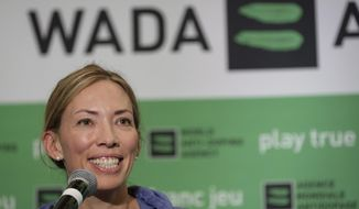"""FILE - In this June 5, 2018, file photo, Beckie Scott, World Anti-Doping Agency athlete committee chairperson, speaks at a news conference following the agency's first Global Athlete Forum in Calgary, Alberta One of her proudest accomplishments was getting an athlete charter of rights approved and into the WADA code book. That happened Thursday, Nov. 7, 2019, the last day of her term as chair.""""My hope is that going forward, voices that challenge or dissent will be heard and taken into consideration rather than undermined or dismissed,"""" Scott said in her speech. """"And my hope is that going forward, balance and independence will be restored to these tables, so that all interests and priorities here are aligned with equality of opportunity and fairness, rather than the business of sport."""". (Jeff McIntosh/The Canadian Press via AP, File)"""
