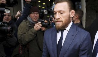 Conor McGregor leaves Dublin District Court in Dublin, Friday, Nov. 1, 2019. McGregor has been fined $1,120 for assaulting a man in a pub. The retired mixed martial arts fighter from Ireland pleaded guilty to a charge of assault during an appearance at Dublin District Court. The 31-year-old McGregor hasn't fought in MMA since losing by submission to Khabib Nurmagomedov in October 2018. (Brian Lawless/PA via AP)