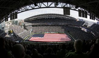 A full-field flag is displayed at CenturyLink Field before an NFL football game between the Seattle Seahawks and the Tampa Bay Buccaneers, Sunday, Nov. 3, 2019, in Seattle. (AP Photo/Scott Eklund)