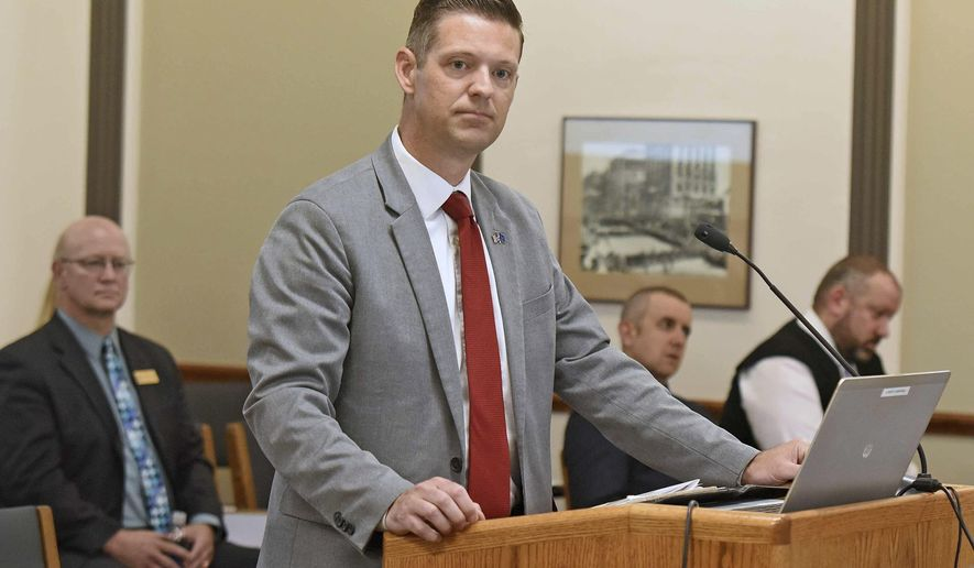 In this July 17, 2019 photo, North Dakota State Auditor Josh Gallion appears before the Legislative Audit and Fiscal Review Committee in the state capitol in Bismarck. Prosecutors have declined to pursue criminal charges against North Dakota State College of Science officials accused of withholding records from investigators.  Gallion issued the report earlier this year that focused on management of the school's career workforce program. It alleged that Tony Grindberg, the school's vice president of workforce affairs and a former state lawmaker, failed to disclose his wife's company that was paid $39,500 to formulate a marketing plan for the program.   (Tomm Stromme/The Bismarck Tribune via AP)