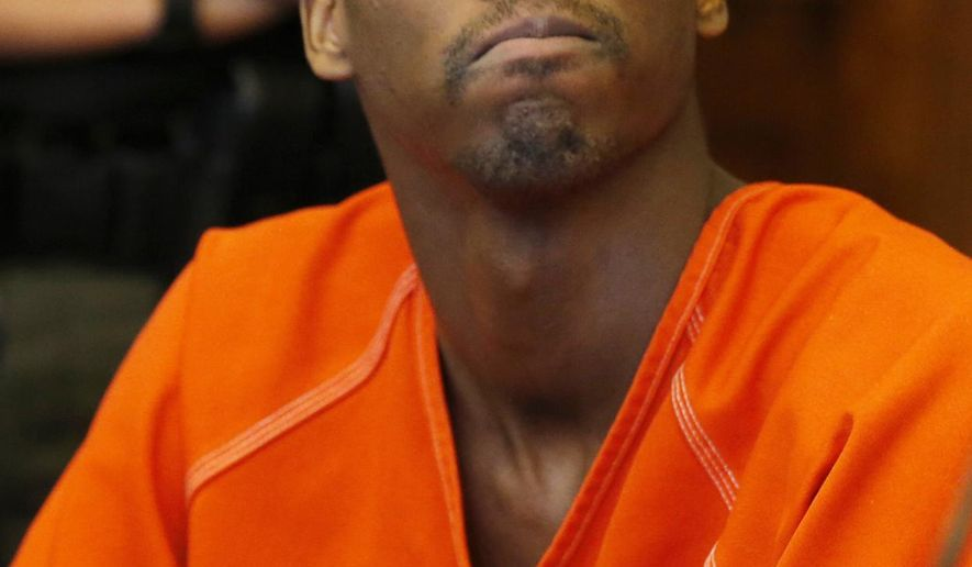 FILE - In this June 29, 2015 file photo, Shawn Ford Jr. looks upward as he listens to Jessica Schobert, the oldest daughter of Margaret and Jeffrey Schobert after he was sentenced to death by Summit County Common Pleas Court Judge Tom Parker for the murder of Margaret Schobert in Akron, Ohio.  The Ohio Supreme Court has rejected the death sentence for Ford Jr., Thursday, Nov. 7, 2019, and ordered a new sentencing hearing. (Karen Schiely/Akron Beacon Journal via AP, File)