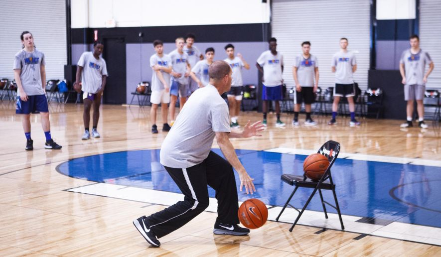 In this Friday, Sept. 20, 2019 photo, Athletes run through drills at Hoop City basketball training facility in Las Vegas. Hoop City gym, home to Impact Basketball, doesn't attract attention. But it does draw some of the most recognizable names in professional basketball to Las Vegas for summer training and workouts. (Yasmina Chavez/Las Vegas Sun via AP)