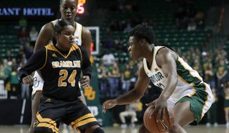 Grambling State guard Alexis Vaughn (24) defends as Baylor's Moon Ursin, right, looks for an opening to the basket in the second half of an NCAA college basketball game in Waco, Texas, Friday, Nov. 8, 2019. Baylor's Queen Egbo, rear, helps defend on the play. (AP Photo/Tony Gutierrez)
