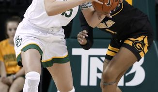 Baylor forward Lauren Cox, left, grabs a defensive rebound in front of Grambling State's Jasmine Forte, right, in the second half of an NCAA college basketball game in Waco, Texas, Friday, Nov. 8, 2019. (AP Photo/Tony Gutierrez)