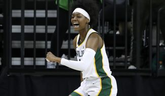 Baylor forward NaLyssa Smith (1) celebrates after sinking a basket in the first half of an NCAA college basketball game against Grambling State in Waco, Texas, Friday, Nov. 8, 2019. (AP Photo/Tony Gutierrez)
