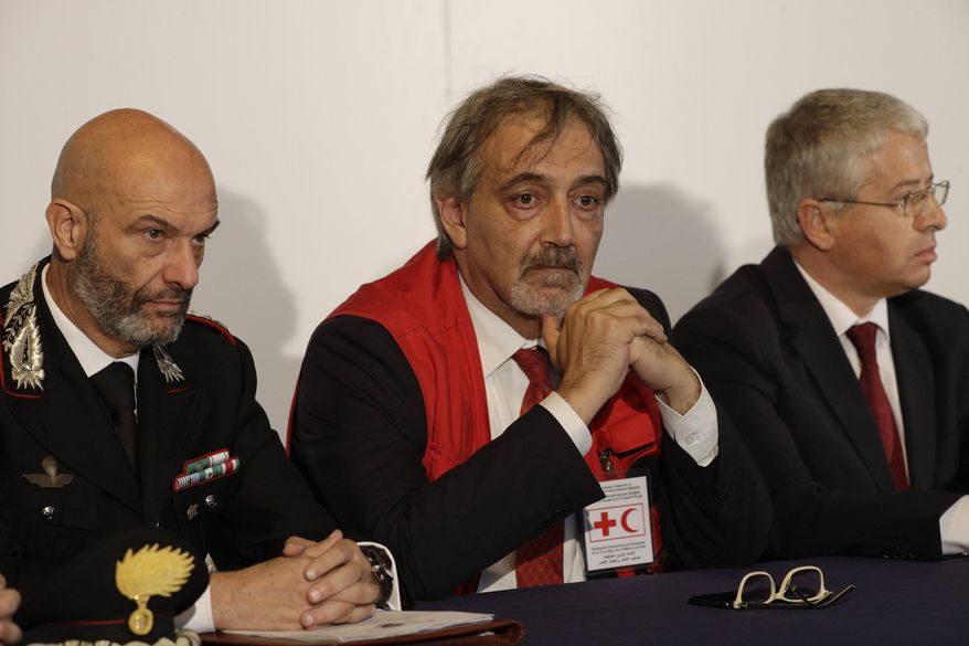 From left, Carabinieri Anti-terrorism Colonel Marco Rosi, IFRC President Francesco Rocca, and Albania's Interior Minister Sander Lleshaj, attend a press conference at Rome's Fiumicino airport Friday, Nov. 8, 2019. 11-year-old Alvin, an Albanian boy who was taken to Syria by his mother when she joined the Islamic State group has been freed from a crowded detention camp in northeastern Syria and returned home to Italy where his father lives. (AP Photo/Gregorio Borgia)