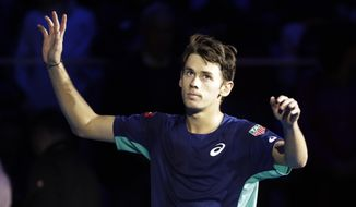Australia's Alex De Minaur celebrates after winning the ATP Next Gen tennis tournament semifinal match against United States' Frances Tiafoe, in Milan, Italy, Friday, Nov. 8, 2019. (AP Photo/Luca Bruno)