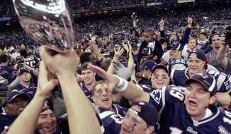 "FILE - In this Feb. 3, 2002, file photo, New England Patriots players reach out to touch the Vince Lombardi Trophy after the Patriots defeated the St. Louis Rams 20-17 to win NFL football Super Bowl 36 in New Orleans. A pair of Super Bowl winning teams that launched dynasties in San Francisco and New England highlighted the list of the NFL's greatest teams, numbers 31-100. Coming in at No. 31 were the 1981 San Francisco 49ers led by coach Bill Walsh and quarterback Joe Montana.  The Patriots won a surprise title in 2001 after the untested Brady took over from the injured Drew Bledsoe early in the season. New England needed a favorable ruling and dramatic kick by Adam Vinatieri to win the ""Tuck Rule"" game against Oakland, won at Pittsburgh in the AFC championship game and slowed down the dynamic Rams offense for the franchise's first title. That team ranked 51st. (AP Photo/David J. Philli, File)"