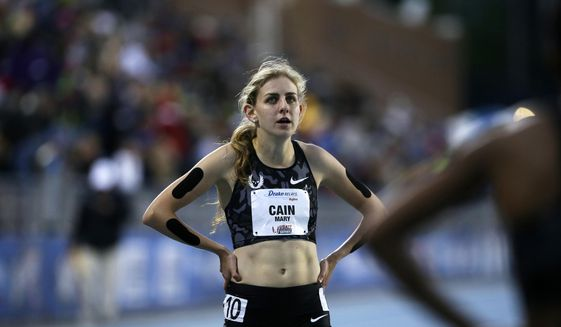 In this April 29, 2016, file photo, Mary Cain walks off the track after competing in the women's special 1500-meter run at the Drake Relays athletics meet, in Des Moines, Iowa. Nike will investigate allegations of abuse by runner Mary Cain while she was a member of Alberto Salazar's training group. Cain joined the disbanded Nike Oregon Project run by Salazar in 2013, soon after competing in the 1,500-meter final at track and field's world championships when she was 17. (AP Photo/Charlie Neibergall, File) **FILE**