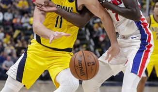 Indiana Pacers forward Domantas Sabonis (11) gets tangled up with Detroit Pistons forward Thon Maker (7) during the second half of an NBA basketball game in Indianapolis, Friday, Nov. 8, 2019. The Pacers won 112-106. (AP Photo/Michael Conroy)