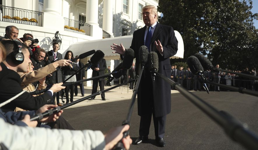 President Donald Trump speaks to reporters on the South Lawn of the White House in Washington, Friday, Nov. 8, 2019, before boarding Marine One for a short trip to Andrews Air Force Base, Md. and then on to Georgia to meet with supporters. (AP Photo/Andrew Harnik)