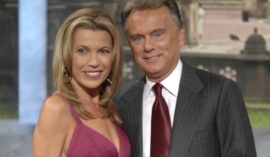 """In this Sept. 29, 2007 file photo, co-host Vanna White and host Pat Sajak make an appearance at Radio City Music Hall for a taping of celebrity week on """"Wheel of Fortune"""" in New York. Sajak had to have emergency surgery, and his longtime sidekick Vanna White is filling in as host while he recovers. The show says on its social media accounts that the Thursday. Nov. 7, 2019, taping was canceled as the 73-year-old Sajak underwent successful emergency surgery to correct a blocked intestine. (AP Photo/Peter Kramer, file)"""