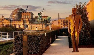 A new statue of Ronald Reagan at the U.S, Embassy in Berlin overlooking the Brandenburg Gate, site of an iconic Cold War speech. (Image from Reagan Presidential Foundation and Institute)