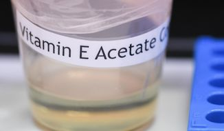 This Monday, Nov. 4, 2019 photo shows a vitamin E acetate sample during a tour of the Medical Marijuana Laboratory of Organic and Analytical Chemistry at the Wadsworth Center in Albany, N.Y. On Friday, Nov. 8, 2019, the Centers for Disease Control and Prevention in Atlanta said fluid extracted from 29 lung injury patients who vaped contained the chemical compound in all of them. (AP Photo/Hans Pennink)