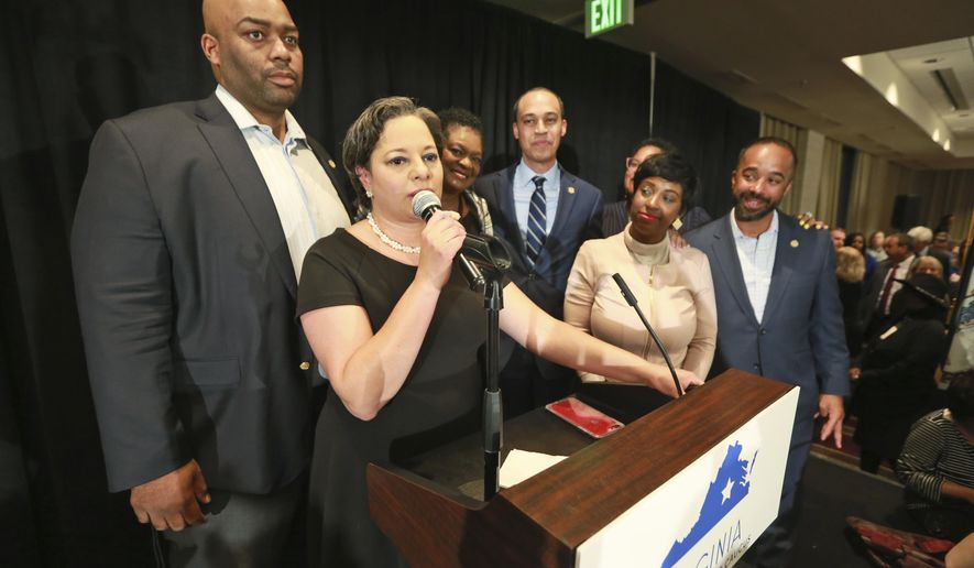 In this Tuesday, Nov. 5, 2019, photo, state State Sen. Jennifer McClellan, D-Richmond, front, speaks to supporters as she is joined by Del. Lamont Bagby, D-Henrico, left, and other members of the Legislative Black Caucus at a Democratic victory party in Richmond, Va. The caucus has made significant gains since the Blackface scandal and a black woman is in the mix for the new House speaker. (AP Photo/Steve Helber)