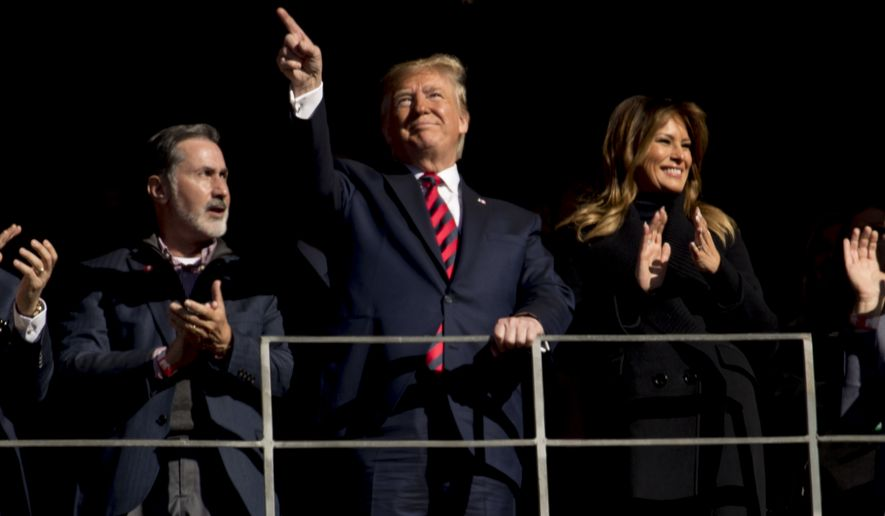 President Donald Trump and first lady Melania Trump are recognized during a NCAA college football game between LSU and Alabama at Bryant-Denny Stadium, in Tuscaloosa, Ala., Saturday, Nov. 9, 2019. (AP Photo/Andrew Harnik)