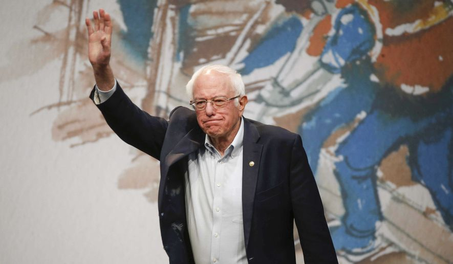 Democratic presidential candidate Sen. Bernie Sanders, I-Vt., waves to supporters on Saturday, Nov. 9, 2019, at Drake University in Des Moines, Iowa.  (Bryon Houlgrave /The Des Moines Register via AP)