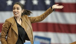 Rep. Alexandria Ocasio-Cortez, D-N.Y., campaigns for Democratic presidential candidate Sen. Bernie Sanders, I-Vt., on the campus of Iowa Western Community College in Council Bluffs, Iowa, Friday, Nov. 8, 2019. (AP Photo/Nati Harnik)