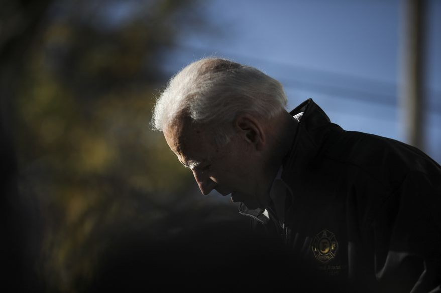 Democratic presidential candidate former Vice President Joe Biden leans his head down while talking about his own personal experiences with fire fighters a Fire Fighter Chili and Canvass Kickoff in Concord, N.H. Saturday, Nov. 9, 2019: (AP Photo/ Cheryl Senter)