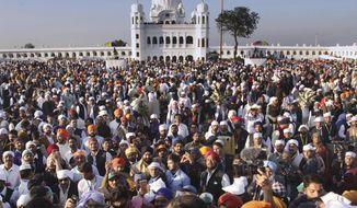 Sikh pilgrims visit the shrine of their spiritual leader Guru Nanak Dev, at Gurdwara Darbar Sahib in Kartarpur, Pakistan. Pakistan's prime minister Imran Khan has inaugurated a visa-free initiative that allows Sikh pilgrims from India to visit one of their holiest shrines. Khan opened the border corridor on Saturday as thousands of Indian pilgrims waited to visit the Kartarpur shrine. (AP Photo/K.M. Chaudary)