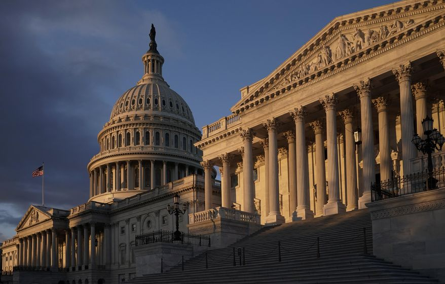 The Capitol is seen in Washington, early Friday, Nov. 8, 2019, as House Democrats continue to probe whether President Donald Trump violated his oath of office by coercing Ukraine to investigate political rival Joe Biden and his family. Rep. Adam Schiff, chairman of the House Intelligence Committee, is releasing key transcripts from hours of closed-door interviews in the impeachment inquiry as they prepare for public sessions with witnesses next week. (AP Photo/J. Scott Applewhite)