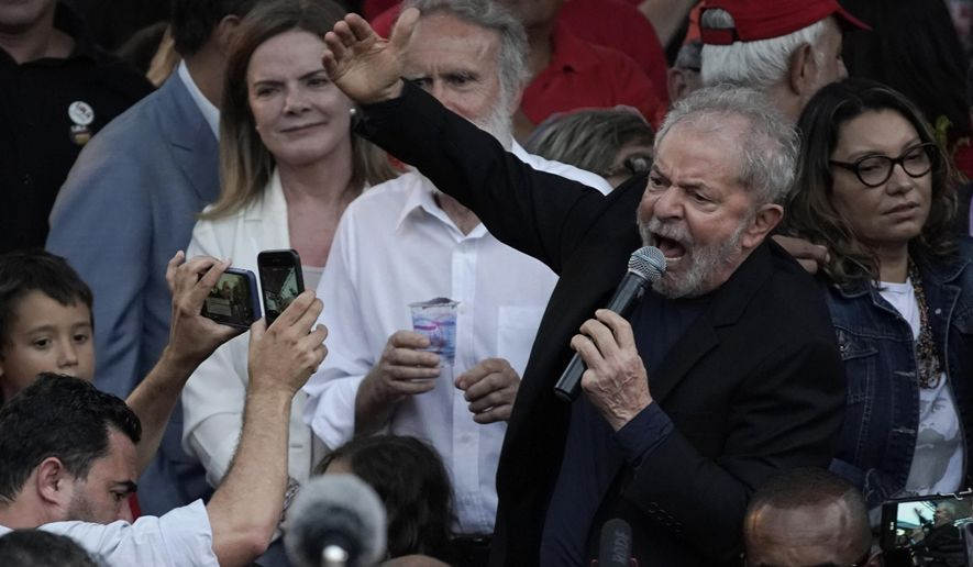 Brazil's former President Luiz Inacio Lula da Silva speaks to supporters after he was released from jail where he was imprisoned on corruption charges in Curitiba, Brazil, Friday, Nov. 8, 2019. Da Silva walked out of prison less than a day after the Supreme Court ruled that a person can be imprisoned only after all the appeals have been exhausted. (AP Photo/Leo Correa)