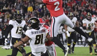 CORRECTS LOCATION TO ATHENS, INSTEAD OF ATLANTA - Georgia defensive back Richard LeCounte goes up to intercept a Missouri pass intended for tight end Albert Okwuegbunam during the second quarter of an NCAA college football game on Saturday, Nov. 9, 2019, in Athens, Ga. (Curtis Compton/Atlanta Journal-Constitution via AP)