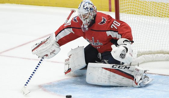 Washington Capitals goaltender Braden Holtby reaches for the puck during the third period of an NHL hockey game against the Vegas Golden Knights, Saturday, Nov. 9, 2019, in Washington. (AP Photo/Nick Wass) ** FILE **