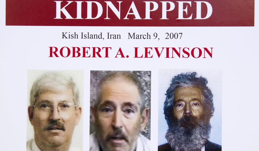 """In this March 6, 2012, file photo, an FBI poster showing a composite image of former FBI agent Robert Levinson, right, of how he would look like now after five years in captivity, and an image, center, taken from the video, released by his kidnappers, and a picture before he was kidnapped, left, displayed during a news conference in Washington. Iran is acknowledging for the first time it has an open case before its Revolutionary Court over the 2007 disappearance of a former FBI agent on an unauthorized CIA mission to the country. In a filing to the United Nations, Iran said the case over Robert Levinson was """"on going,"""" without elaborating. The Associated Press obtained the text of the filing Saturday, Nov. 9, 2019. (AP Photo/Manuel Balce Ceneta, File)"""