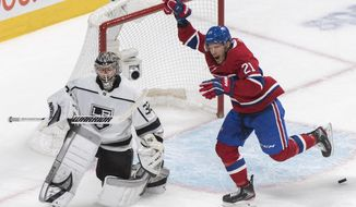 Montreal Canadiens' Nick Cousins (21) celebrates a goal by Shea Weber against Los Angeles Kings goaltender Jonathan Quick during the first period of an NHL hockey game Saturday, Nov. 9, 2019, in Montreal. (Graham Hughes/The Canadian Press via AP)