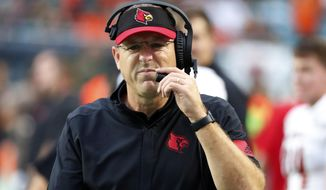 Louisville head coach Scott Satterfield grimaces as he walks the sideline during the first half of an NCAA college football game against Miami, Saturday, Nov. 9, 2019, in Miami Gardens, Fla. (AP Photo/Wilfredo Lee)