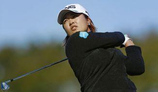 Japan's Ai Suzuki watches her shot during the second round of the LGPA Japan Classic golf tournament in Otsu, Shiga prefecture, western Japan Saturday, Nov. 9, 2019. (Kyodo News via AP)