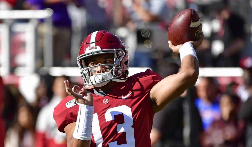 Alabama quarterback Tua Tagovailoa (13) warms up before an NCAA football game against LSU, Saturday, Nov. 9, 2019, in Tuscaloosa , Ala. (AP Photo/Vasha Hunt)) **FILE**