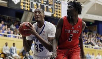 Seton Hall center Romaro Gill (35) drives to the basket past Stony Brook forward Mouhamadou Gueye (5) during the second half of an NCAA college basketball game, Saturday, Nov. 9, 2019, in South Orange, N.J. Seton Hall won 74-57. (AP Photo/Adam Hunger)
