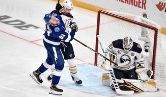 Tampa's Steven Stamkos tries to score past Buffalo's Rasmus Dahlin and goalie Carter Hutton during a NHL Global Series hockey match between the Buffalo Sabres and Tampa Bay Lightning at the Globen Arena, in Stockholm Sweden, Saturday, Nov. 9, 2019. ( Jessica Gow/TT News Agency via AP)